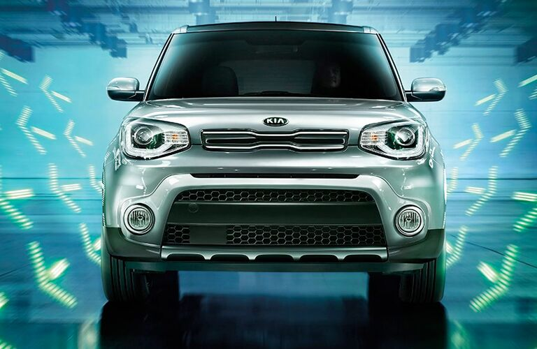 Head-on view of a silver 2019 Kia Soul in a futuristic digital environment.