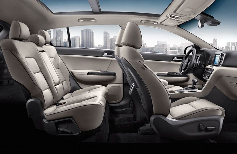 The interior side view of a 2019 Kia Sportage, showcasing the spacious two rows of seats.