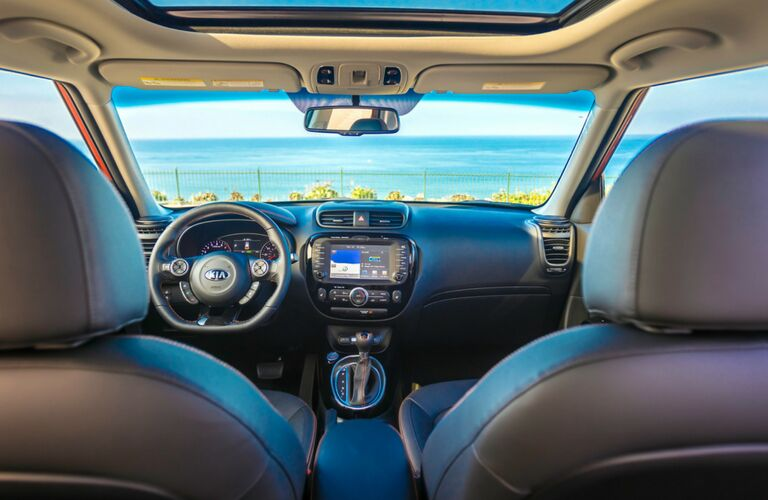 Interior front row view from back middle seat of the 2019 Kia Sorento. A lovely ocean vista stretches out beyond the windshield.