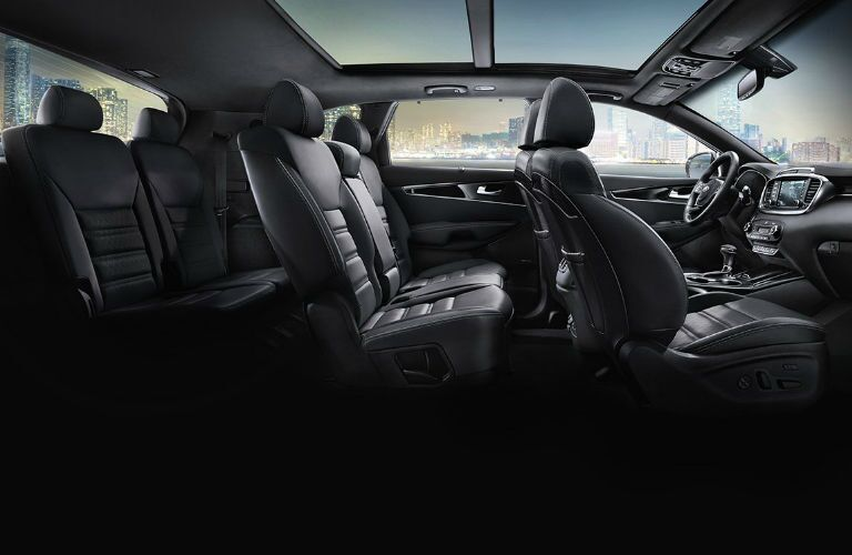 Cutaway side view of a 2019 Kia Sorento, showcasing the three rows of seats.