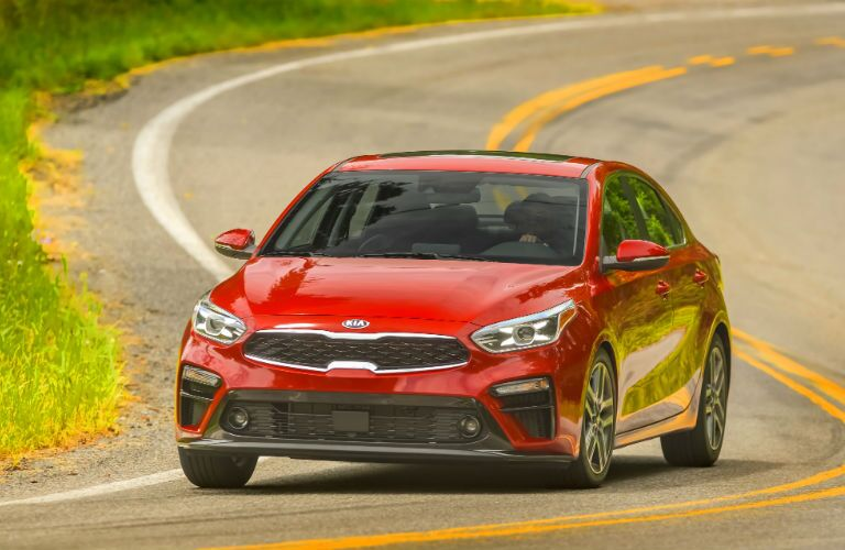 A head-on photo of the 2021 Kia Forte on the road.