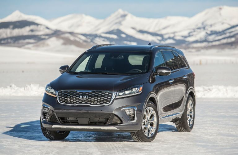 A front photo of the 2020 Kia Sorento parked in the snow.
