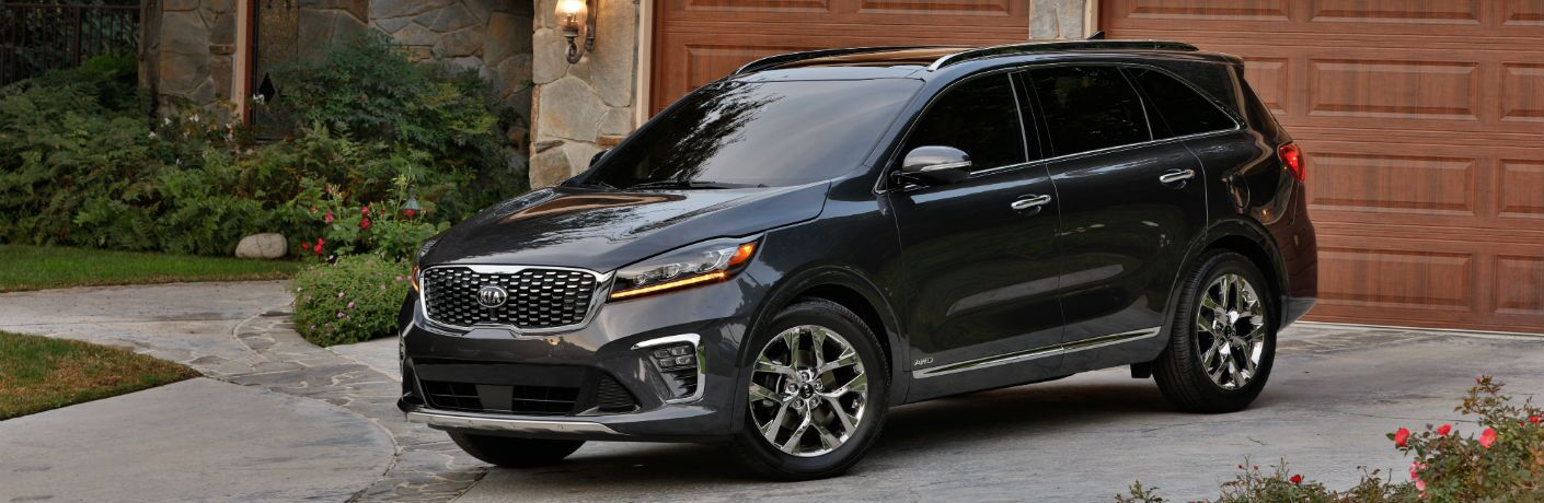 A front left quarter photo of the 2020 Kia Sorento parked in a driveway.