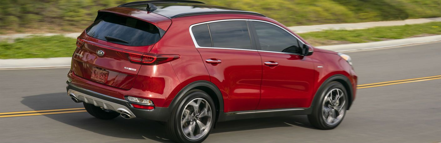 A right profile photo of the 2020 Kia Sportage on the road.