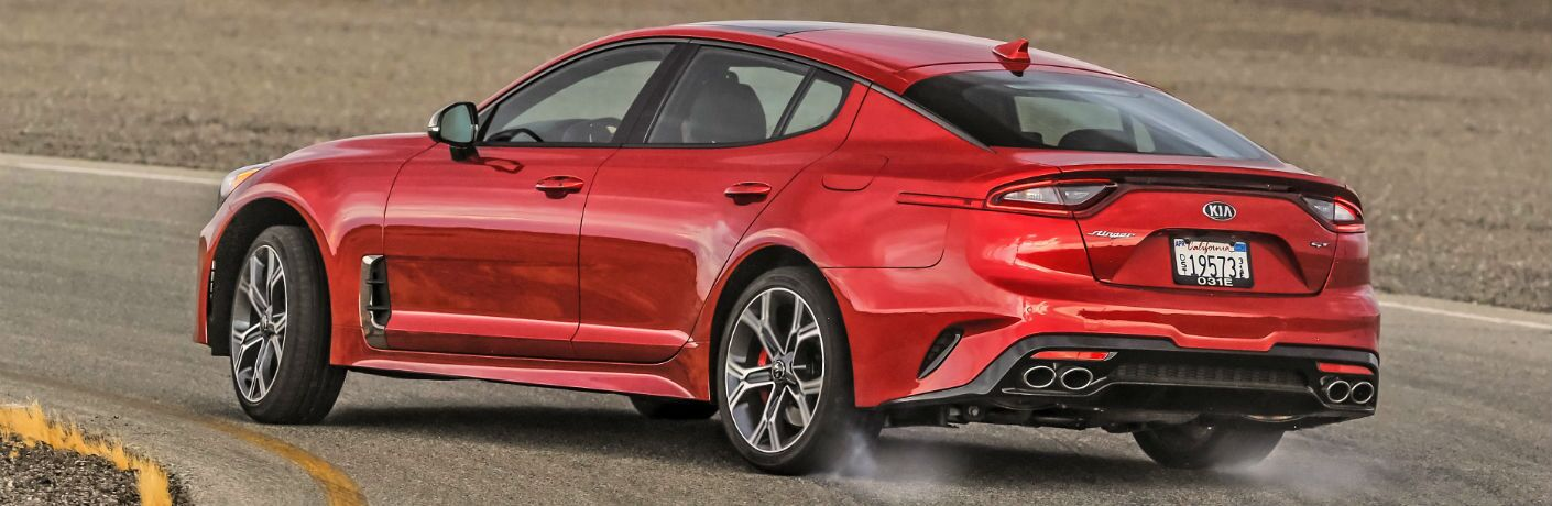 A photo of the 2020 Kia Stinger going around a turn on a race track.