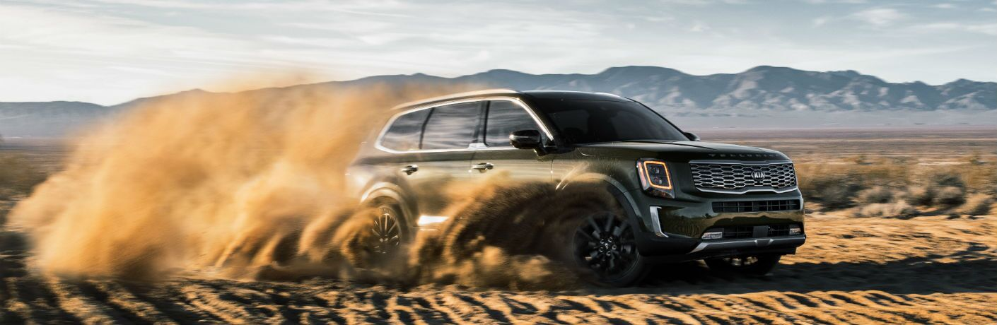 A photo of the 2020 Kia Telluride driving through the desert.