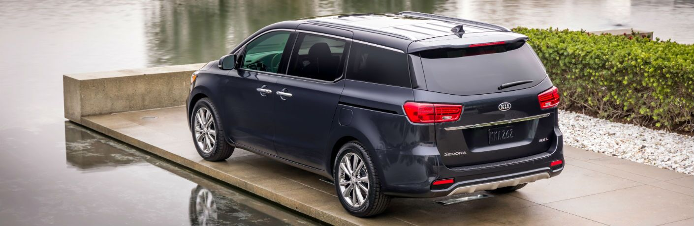 A rear left quarter photo of the 2021 Kia Sedona.