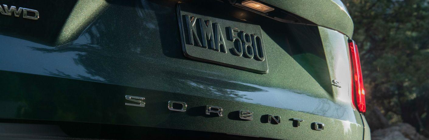 A photo of the Sorento badge used on the back of the 2021 Kia Sorento.