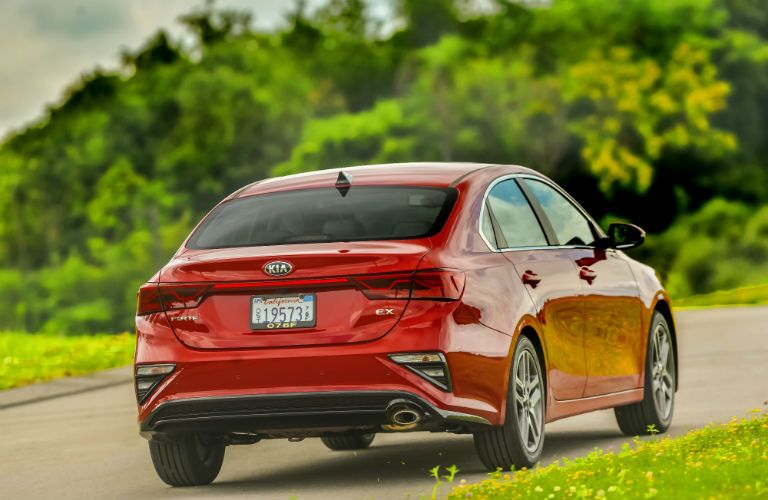 A rear photo of the 2020 Kia Forte on the road.