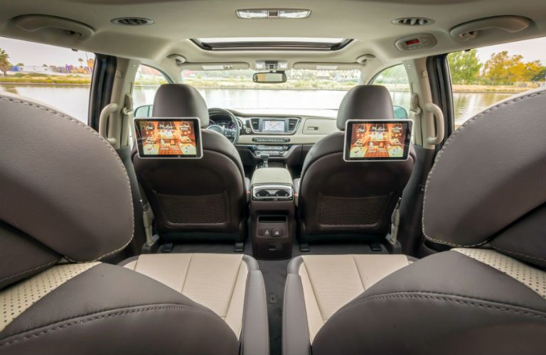 A photo of the many seating spots in the 2021 Kia Sedona with its entertainment system installed.