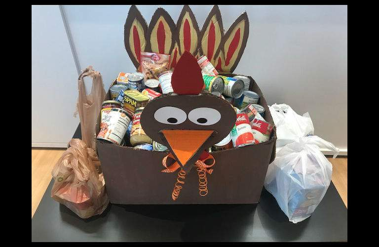 a cardboard turkey filled with non-perishable food (Trotter the Turkey of Team Gunther Kia)