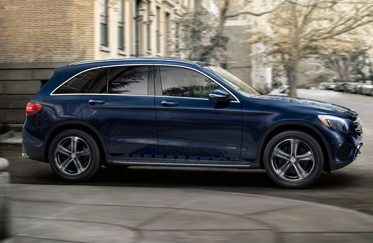 blue 2017 Mercedes-Benz GLC driving through city