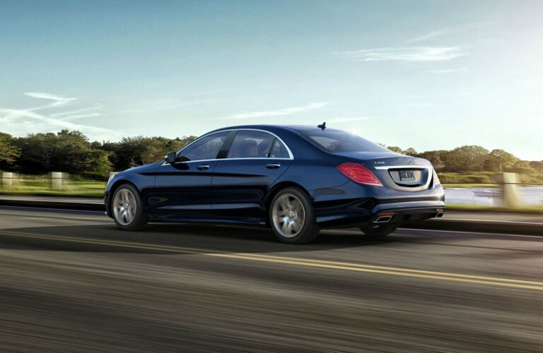 Blue 2017 Mercedes-Benz S-Class driving along road