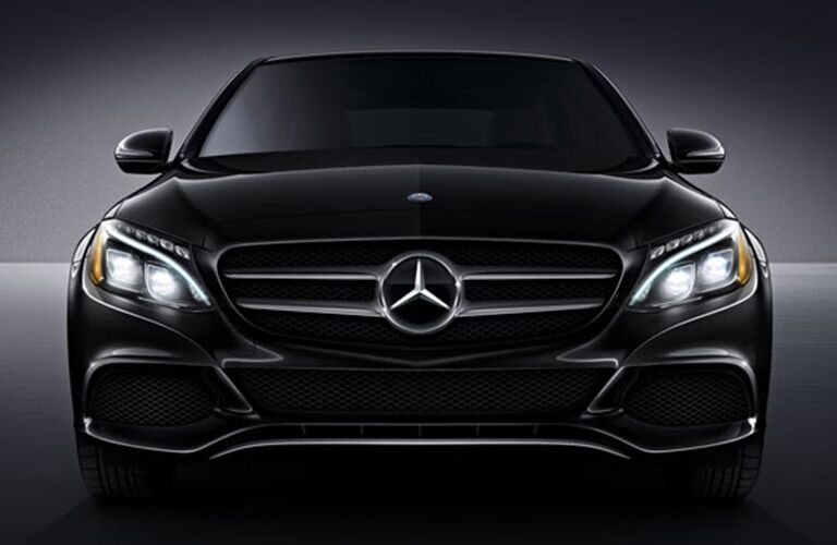 front bumper, grille and headlights of black 2018 mercedes-benz c-class sedan