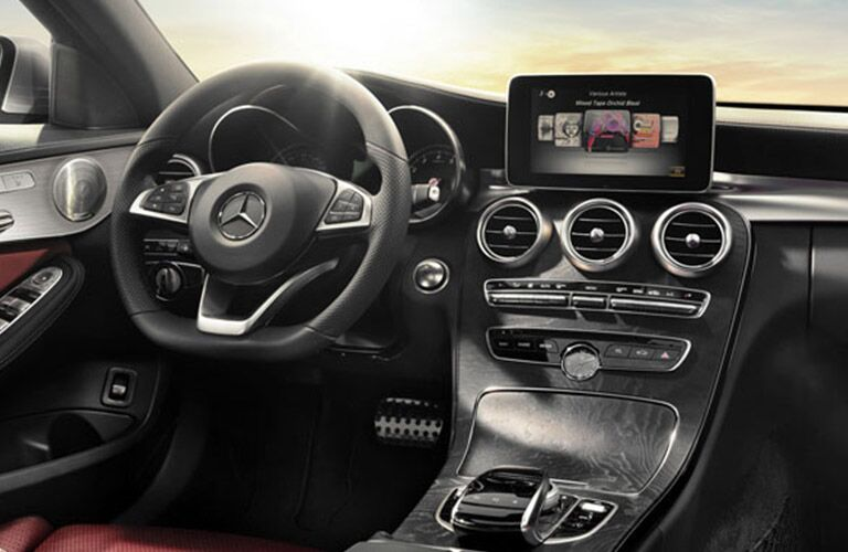 front interior of 2018 mercedes-benz c-class sedan including steering wheel and infotainment system