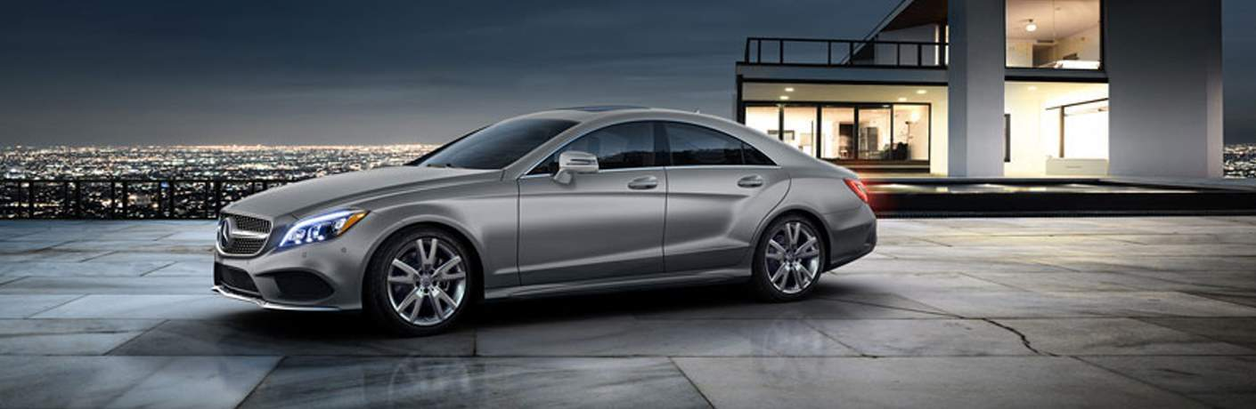side view of a silver 2018 Mercedes-Benz CLS Coupe parked outside a house
