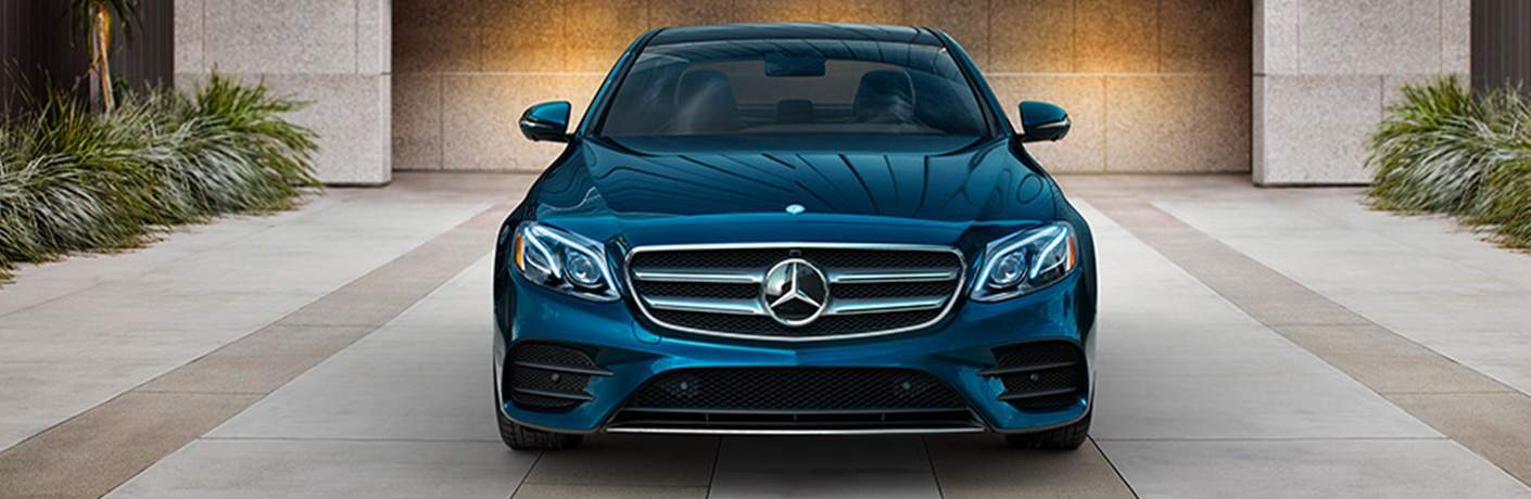 front view of a blue 2018 Mercedes-Benz E-Class Sedan parked in a driveway