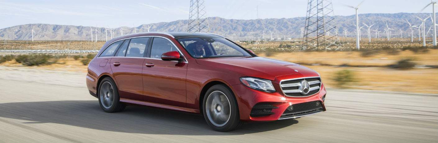 red 2018 Mercedes-Benz E-Class Wagon driving down a dessert road