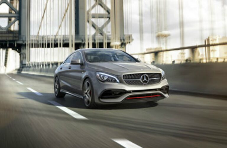 Silver 2018 Mercedes-Benz CLA driving along bridge