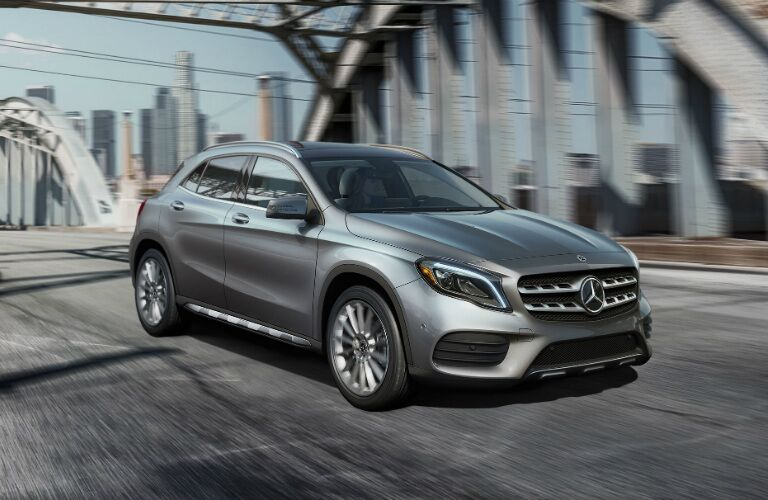 Silver 2018 Mercedes-Benz GLA driving along bridge