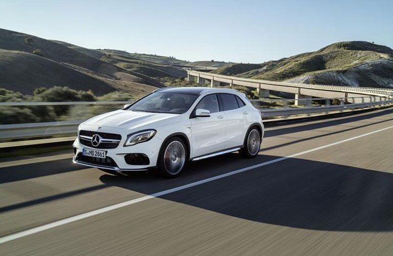 White 2018 Mercedes-Benz GLA driving along highway