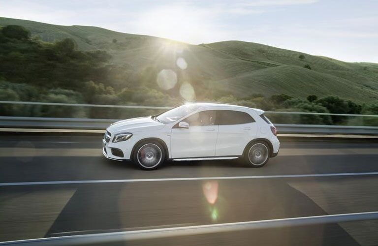 White 2018 Mercedes-Benz GLA driving on scenic road