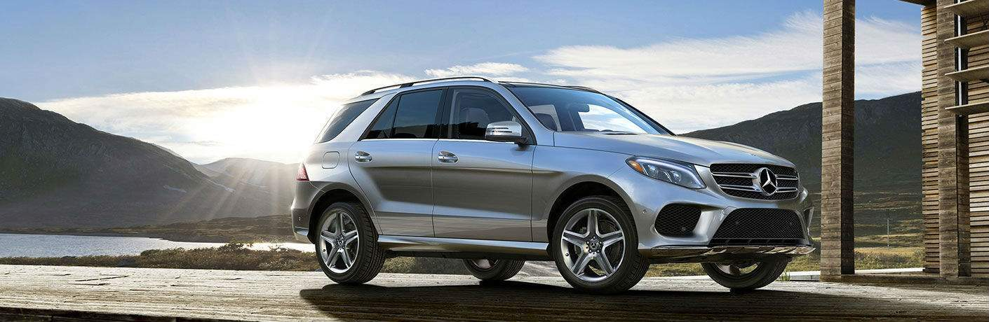 silver 2018 Mercedes-Benz GLE SUV parked near a lake with a sunset in the background