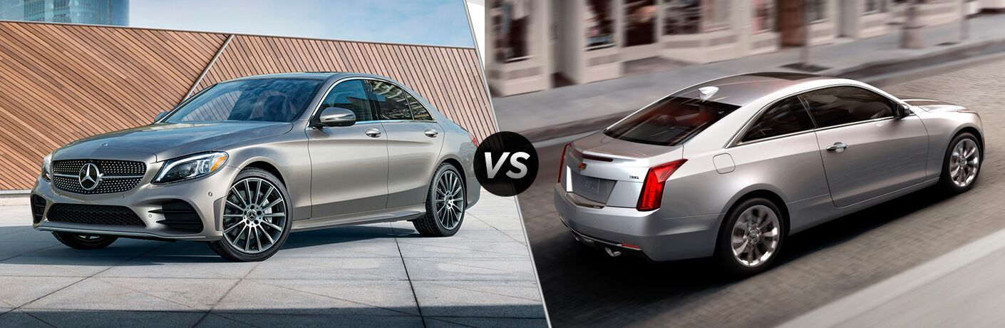 Front driver angle of a grey 2019 Mercedes-Benz C-Class luxury sedan on left VS rear passenger angle of a white 2019 Cadillac ATS on right
