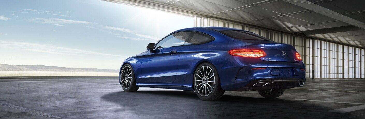 Blue 2020 Mercedes-Benz C-Class Coupe parked in warehouse