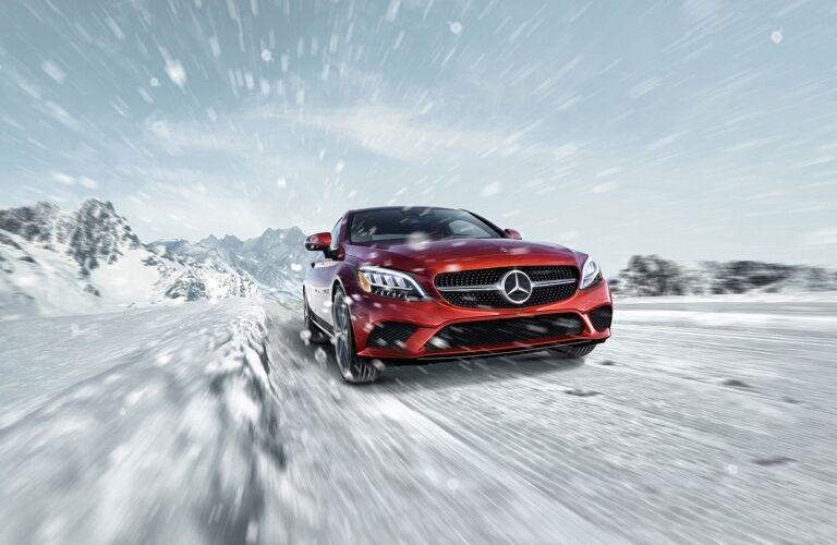 Red 2020 Mercedes-Benz C-Class Coupe driving in snow