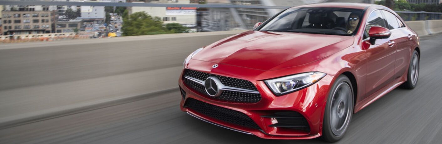 Red 2019 Mercedes-Benz CLS driving on the highway