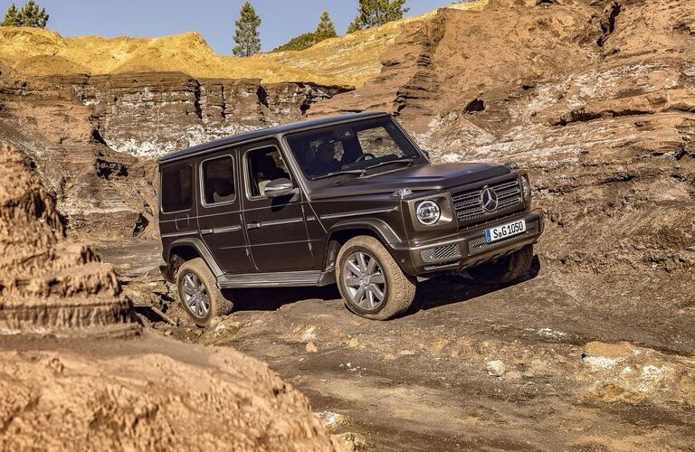 2019 Mercedes-Benz G-Class driving on muddy terrain