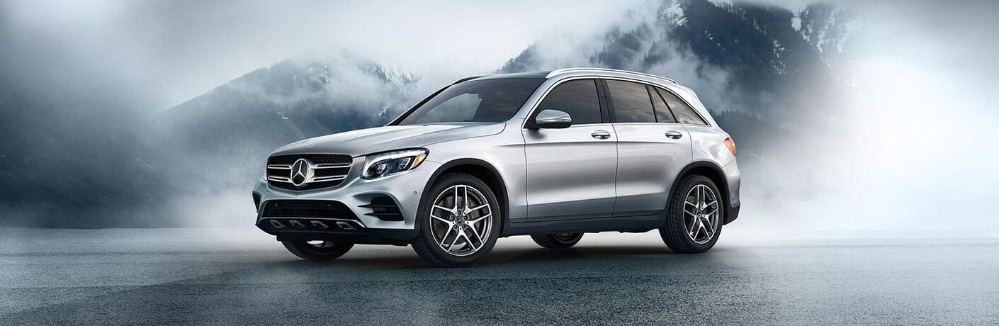 Silver 2019 Mercedes-Benz GLC in front of mountain range