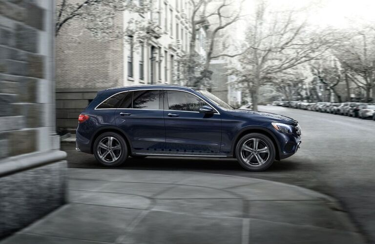 Blue 2019 Mercedes-Benz GLC driving in city