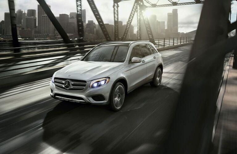 Silver 2019 Mercedes-Benz GLC  driving across bridge