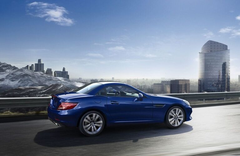 Blue 2019 Mercedes-Benz SLC driving by mountainous city