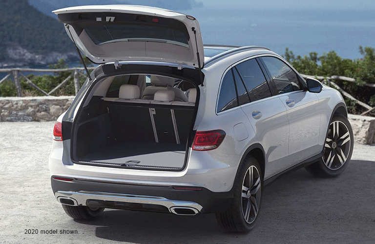 A 2020 Mercedes-Benz GLC as viewed from the outside with the trunk open to reveal the cargo area.