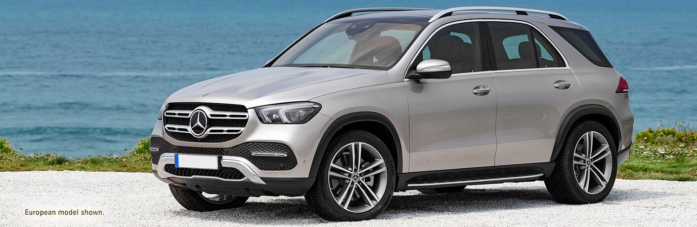 Side view of a silver 2020 Mercedes-Benz GLE in front of water body
