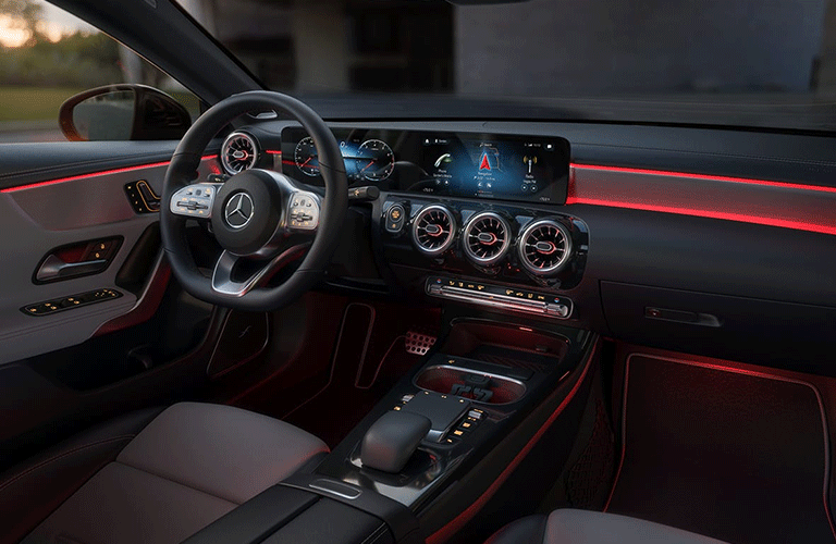 2021 Mercedes-Benz CLA Coupe interior shot of steering wheel, transmission, and dashboard layout