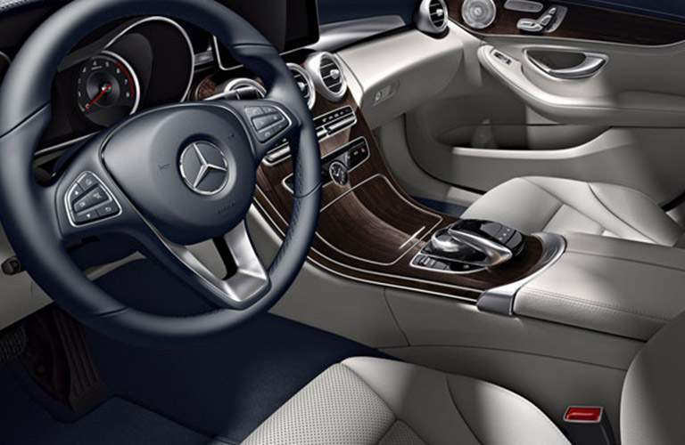Focus on the front center console and the steering wheel of the 2018 Mercedes-Benz C 300