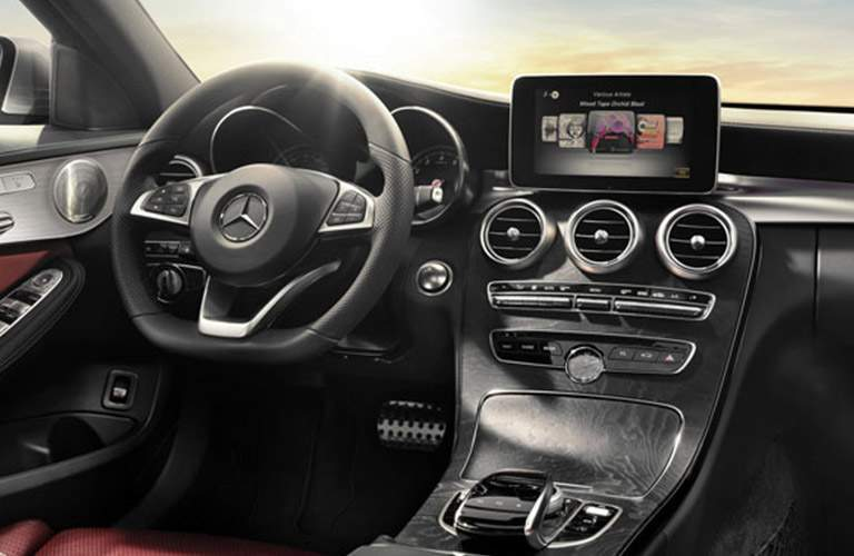 Front interior of the 2018 Mercedes-Benz C 300 with focus on the steering wheel and infotainment system