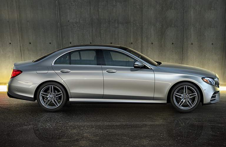 Side Profile of the 2018 Mercedes-Benz E 300 sedan in a dark gray room