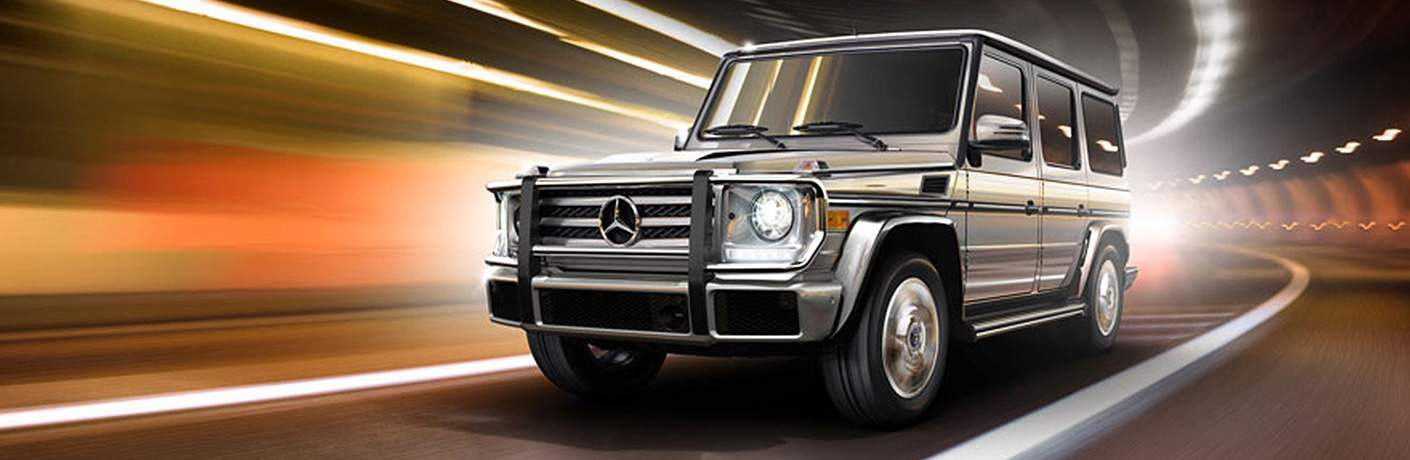 Quarter Side Profile of the 2018 Mercedes-Benz G-Class driving around a curve in a tunnel