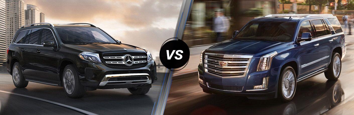 black 2018 Mercedes-Benz GLS set against navy blue 2018 Cadillac Escalade