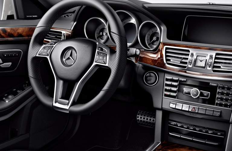2018 Mercedes-Benz E-Class Wagon interior streering wheel and dashboard angled