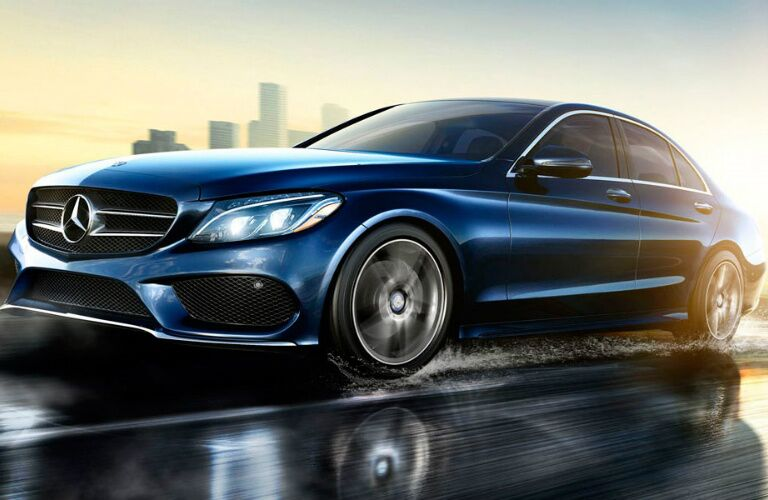 blue 2017 Mercedes-Benz C-Class driving on wet road