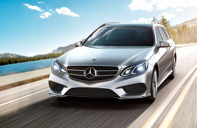 Silver 2017 Mercedes-Benz E-Class Wagon driving near water body