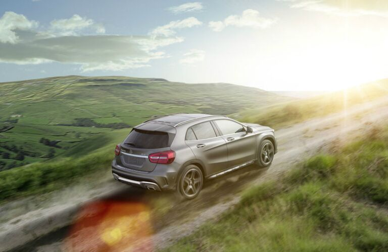 2017 Mercedes-Benz GLA driving uphill on dirt road