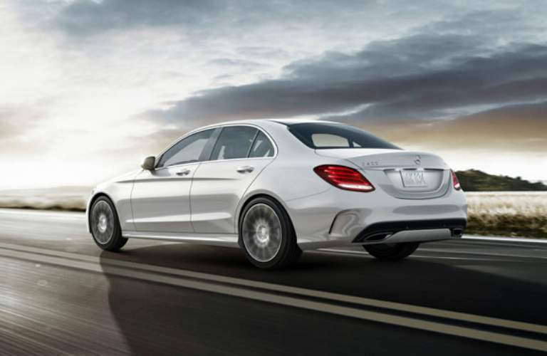 white 2018 Mercedes-Benz C-Class driving on open road