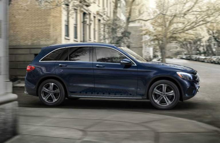 blue 2018 Mercedes-Benz GLC driving on city streets